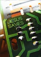 'Jesus Saves' printed on a circuit board